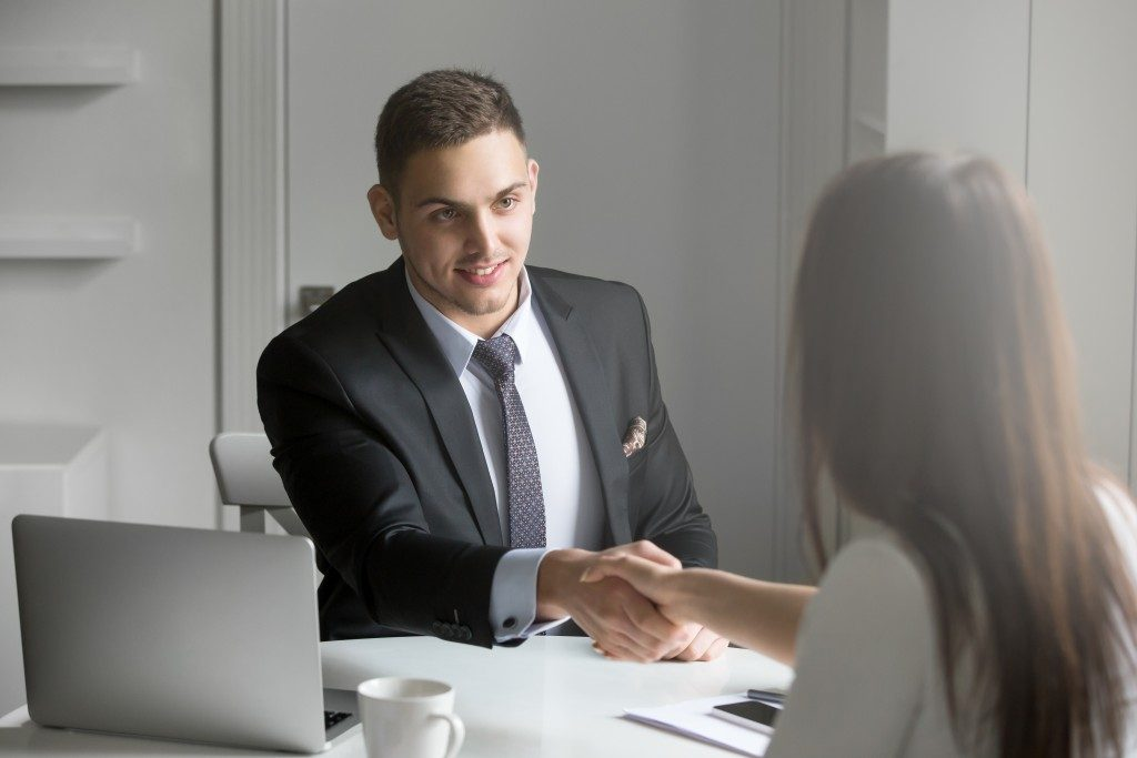 Man shaking hand of applicant