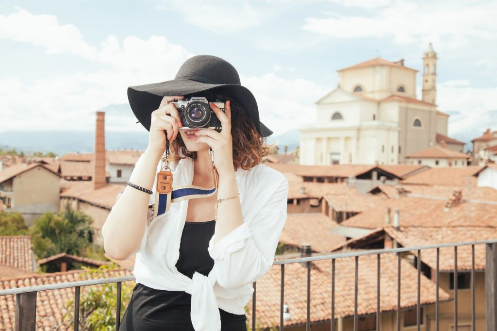woman traveler holding a camera