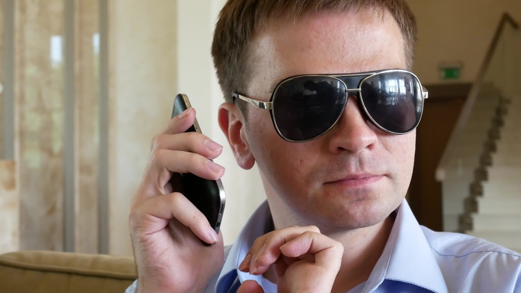 visually impaired man taking a call