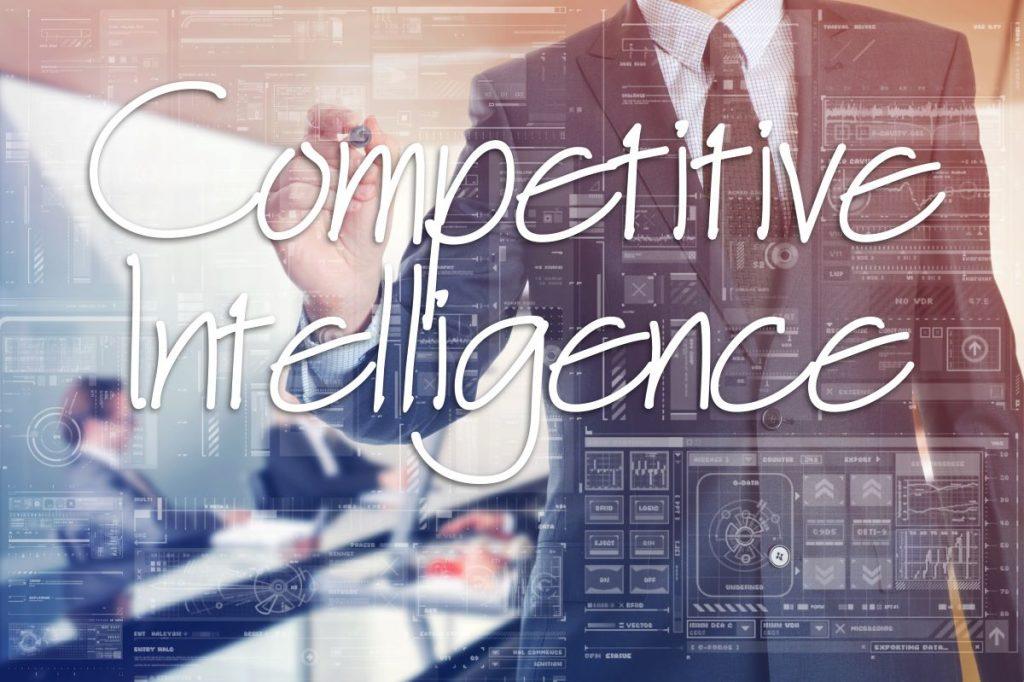 man writing competitive intelligence